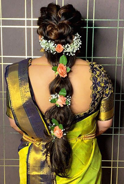 a south indian bride styles her hair with  Bubble braids