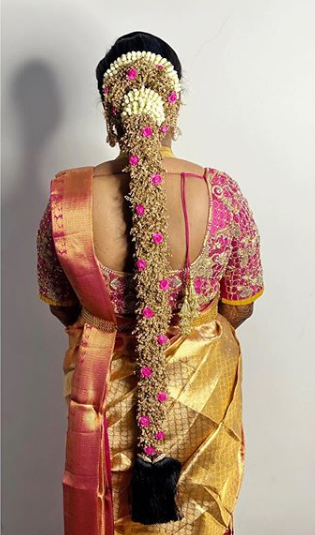 south indian bridal hairstyle with floral jadas