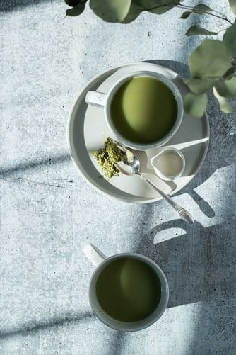 Green tea face pack in a bowl