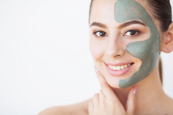 Girl with Green tea face pack applied on face