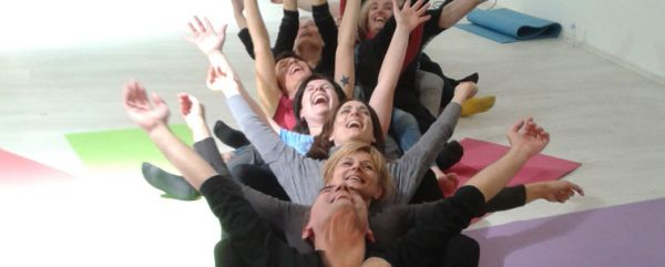 People are doing laughter yoga session