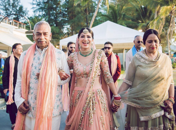 a picture of a bride with her mom and dad