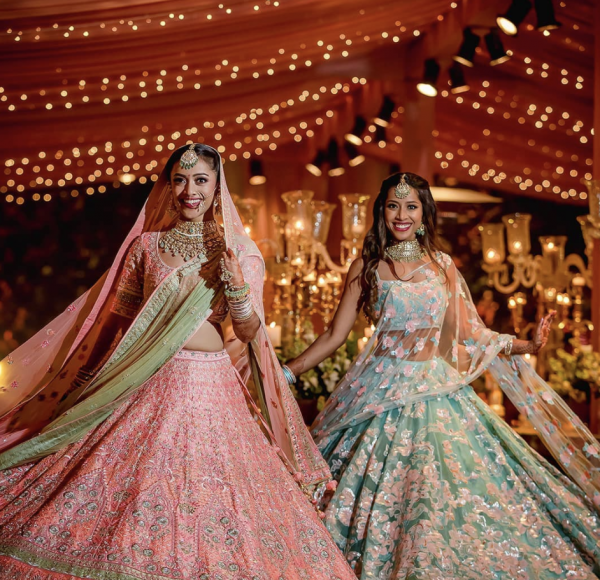a dancing picture of a bride and with her sister