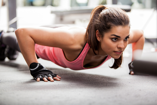 Isometric exercise - A women is doing push ups