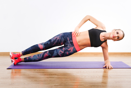 A women doing side plank raises