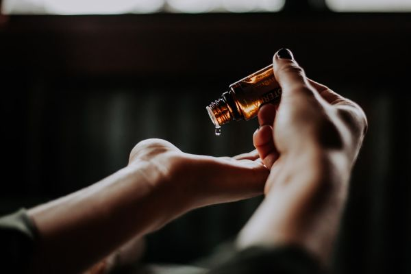 Pouring Lavender Oil on your hand