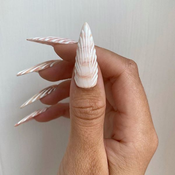 The sea-shell manicure is the perfect way to escape reality