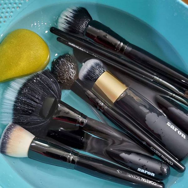Dip your makeup brushes into a bowl of water