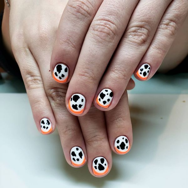 neon cow print nails