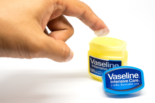 woman scooping out vaseline