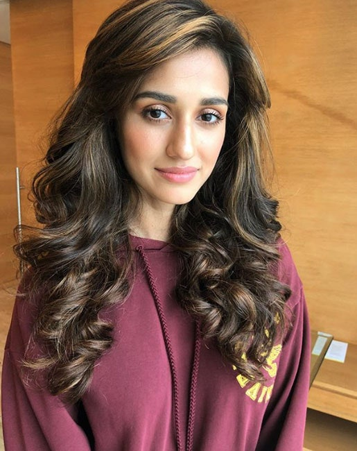 Curl it up Hairstyle for oval face shape