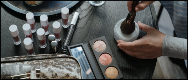 lots of makeup lying on table