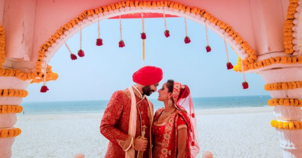 A *Beautiful* Beach Wedding With A Gorgeous Bride In Red... We LOVE!
