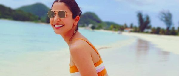 Why So Hot? Anushka Sharma Sizzles By The Beach In An Orange Bikini